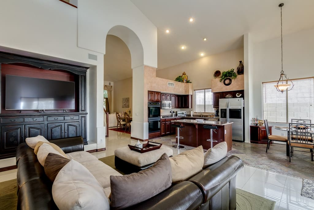Family room, kitchen, eating area with soaring ceilings