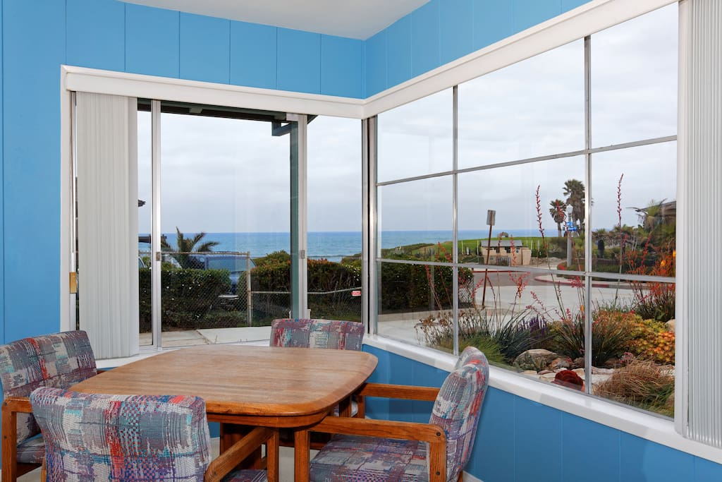 Living/dining room combination with ocean view.
