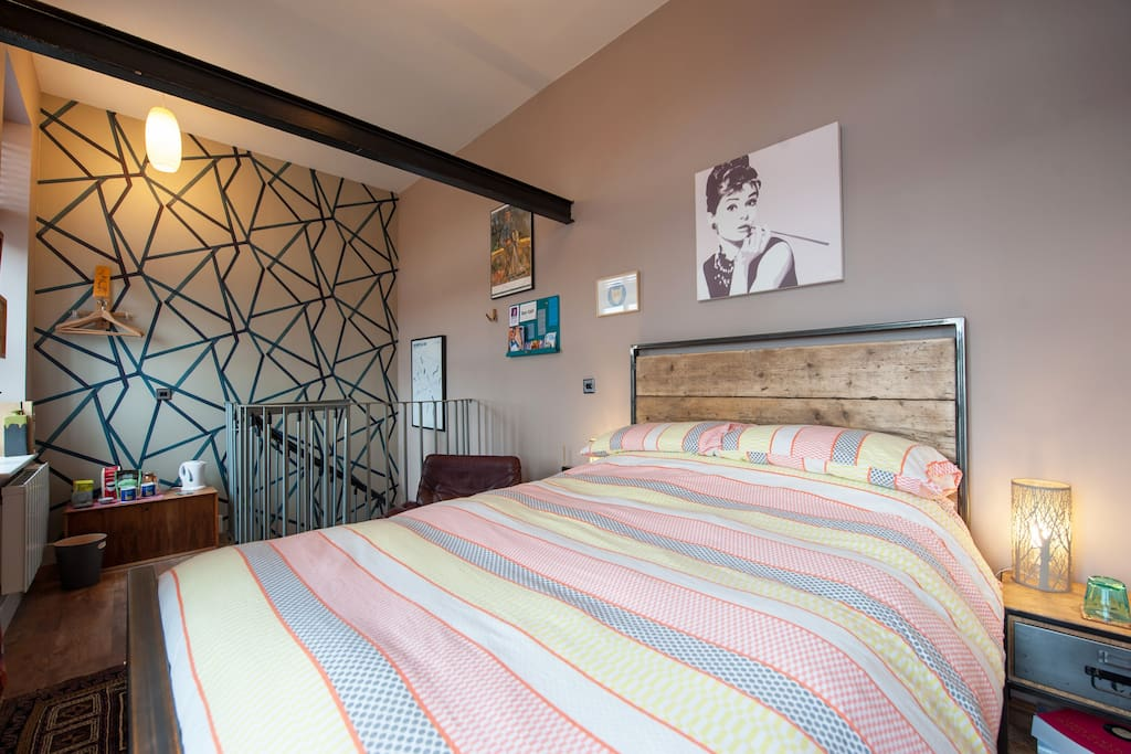 Newley decorated with a hand made bed industrial wood and steel bed from Sheffield