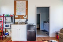 Kitchen space! Microwave, toaster, coffee maker, kettle, and fridge. Everything you'd need for a stay.