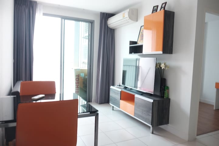 Living room and balcony, washing machine at balcony, Sony TV 50'