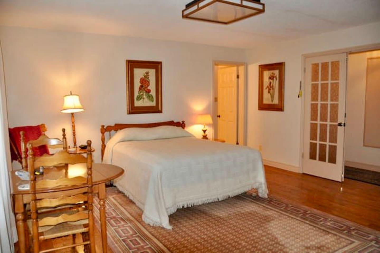 Bedroom with queen bed on main floor.