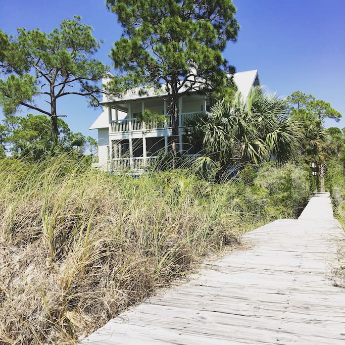 View of home from the beach with private boardwalk