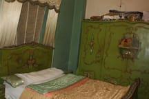 vintage hand-painted bedroom .
