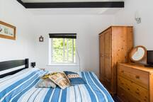 Bedroom with wardrobe and chest of draws