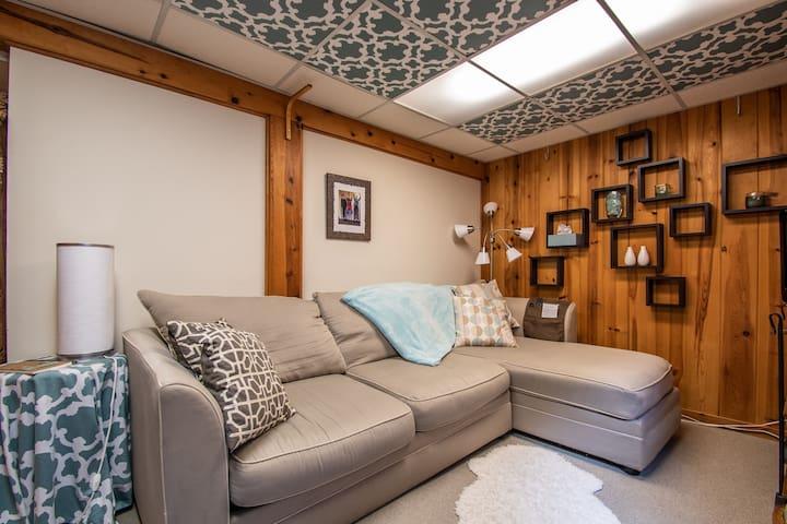 The TV room/second bedroom: stylish, cozy