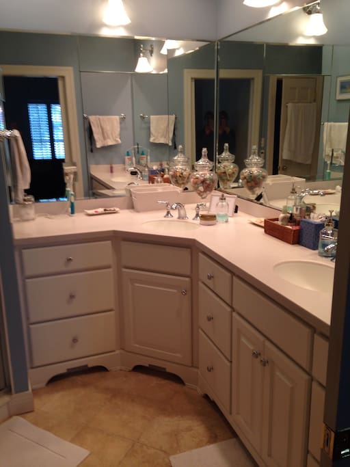 This private  bathroom is in the master bedroom located on the first floor. Two sinks, a heated floor plus a steam shower!