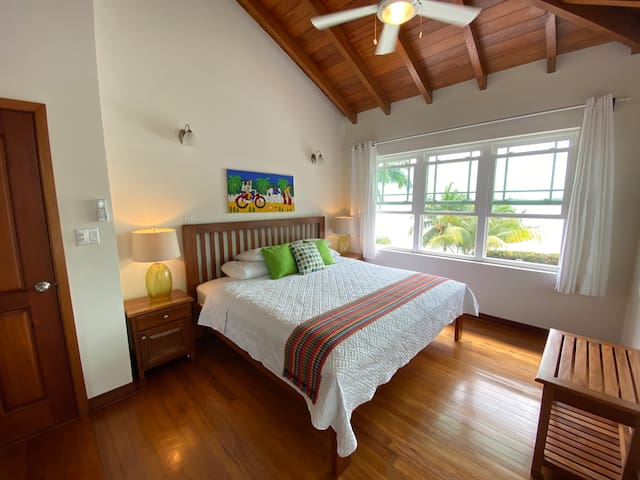 A King size bed with a beautiful view, AC and ceiling fan