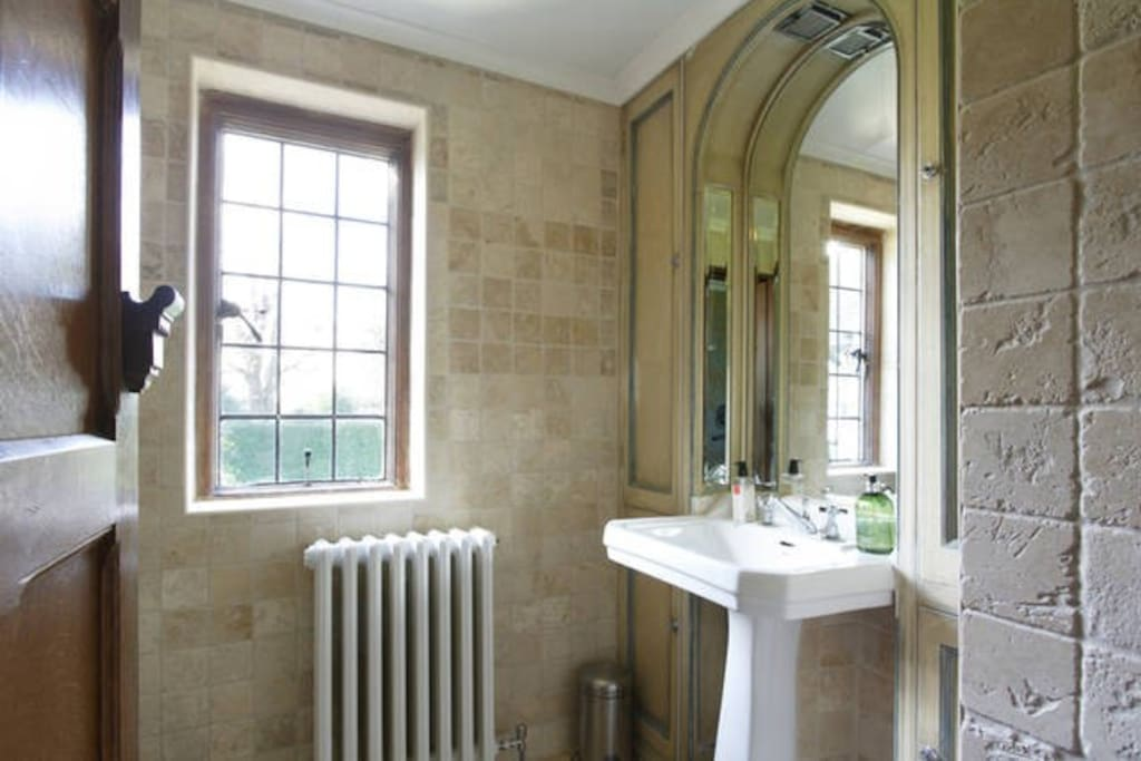 the Garden Room's private bathroom-it has a new power shower and lovely views over our carefully tended gardens