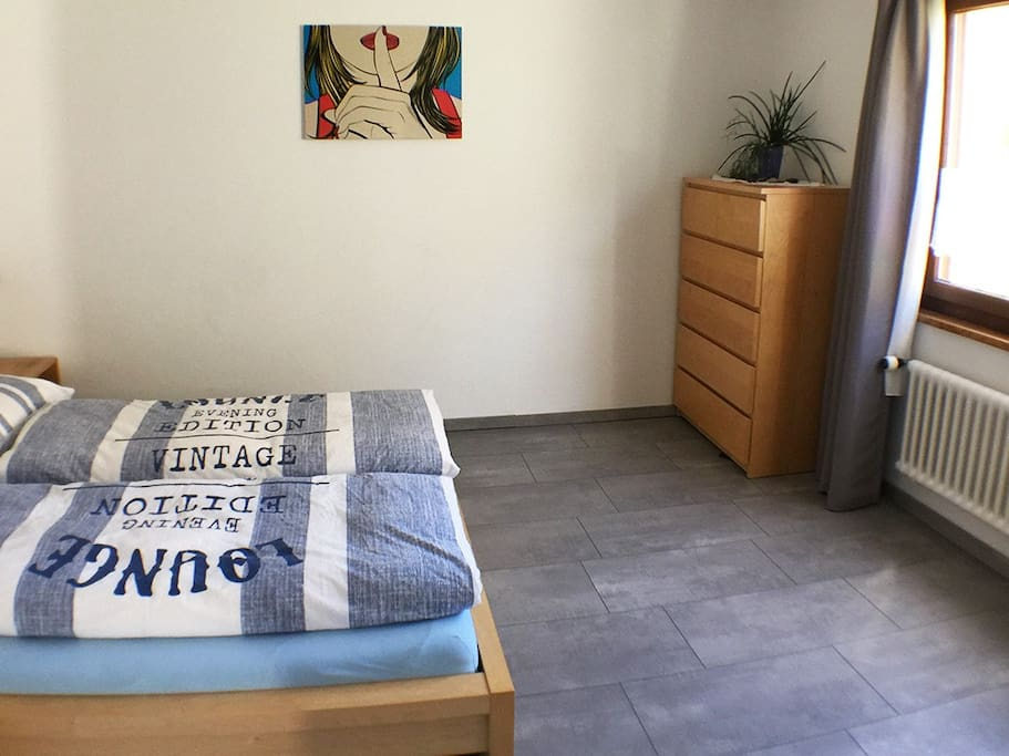 Our light bedroom offers enough space to stow your belongings... if you stay a night or for a lot more! If you would like to wash your clothes, please contact me. For a small price you can wash your clothes so you're ready for new adventures!