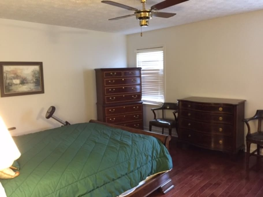 Large master bedroom with high end furniture.