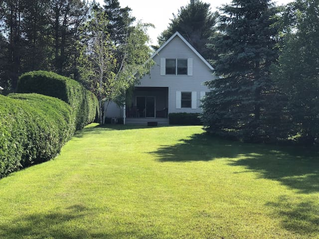 Large lawn with firepit and plenty of room for games, soccer etc. includes kayak, canoe, ping pong and volleyball