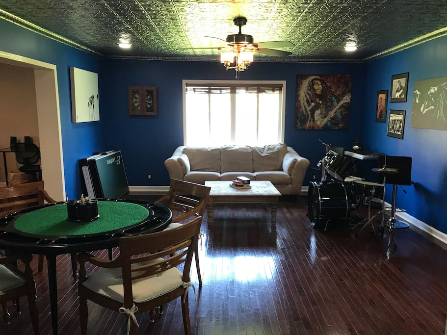 Rec room with a variety of instruments, poker table, ping pong table, dart board, and cards & games