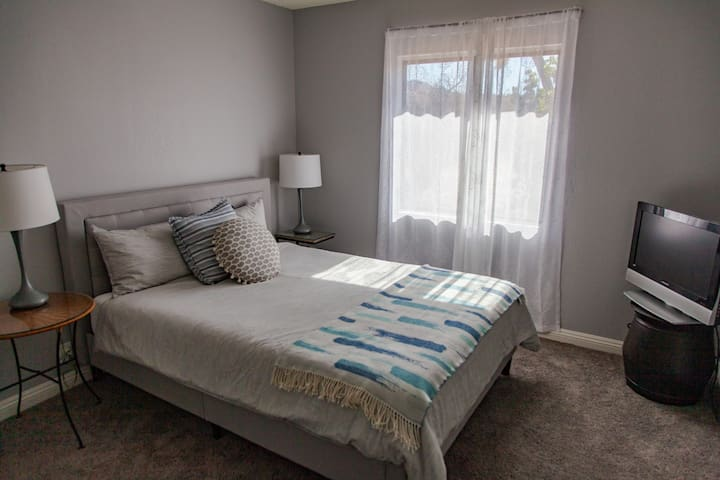 Third smaller bedroom features a large closet and TV with a fully loaded Apple TV.