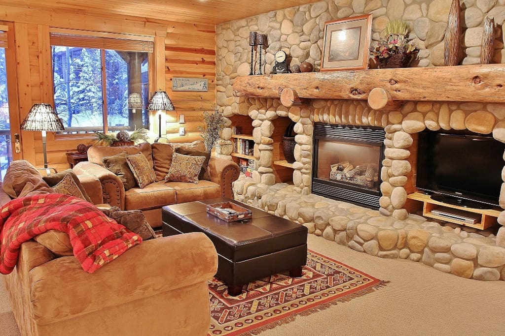 Cozy living room with gas fireplace, HD TV with free HBO and queen sofa sleeper bed