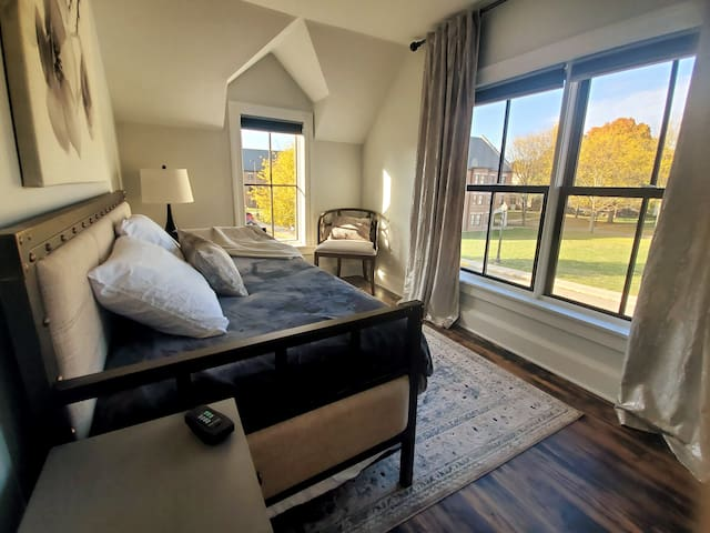 Small bedroom with gorgeous views and a trundle bed.