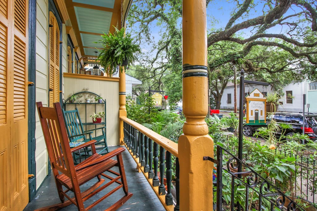 Front porch w/ rocking chairs to enjoy the second lines and Jazz processions