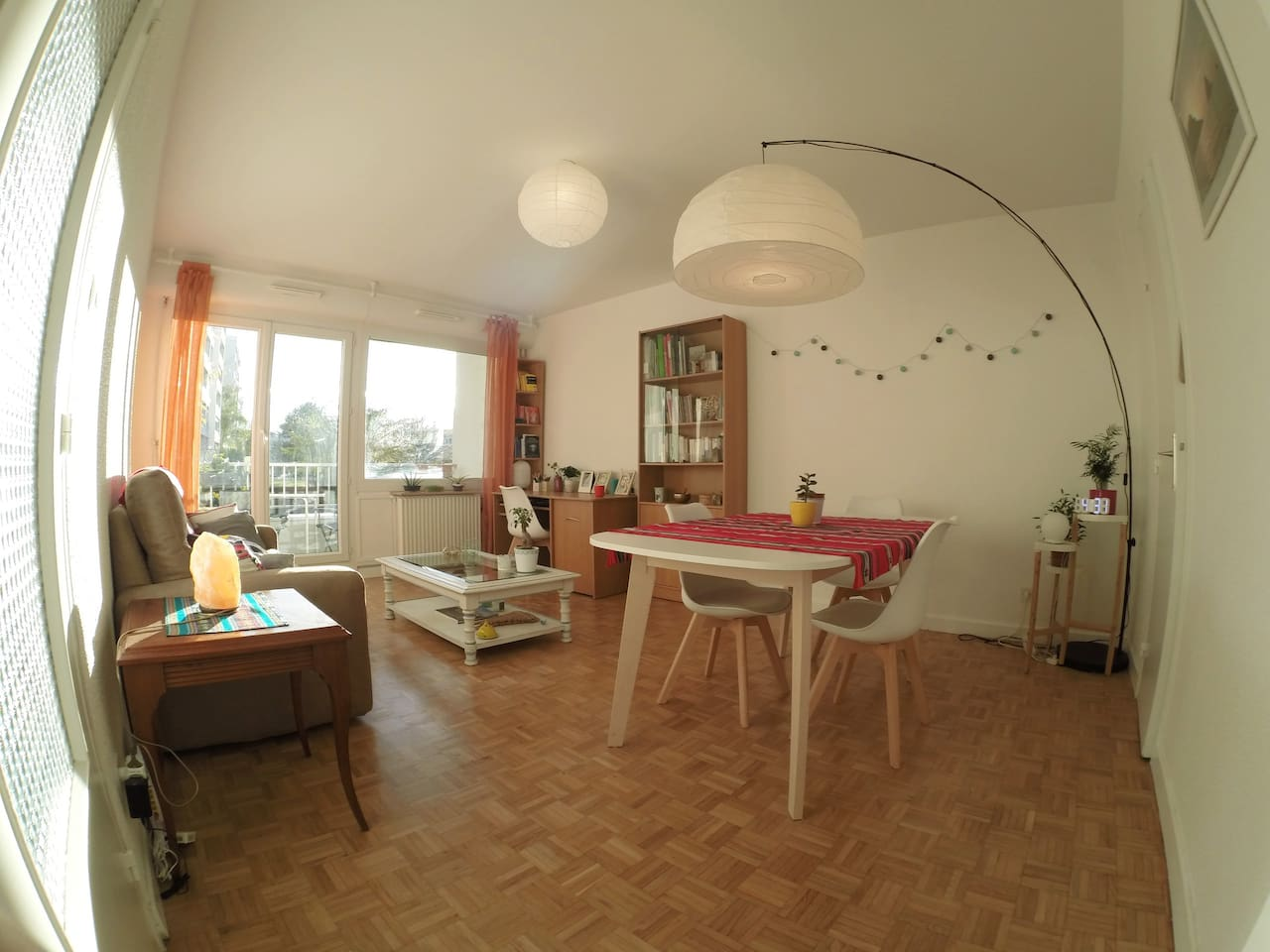 Big living-room with bed-couch, table for eight and balcony with a beautiful view of the garden