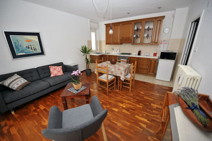 Living room opens up to kitchen.