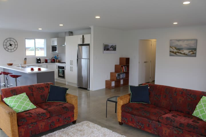 Spacious lounge and brand new modern kitchen.