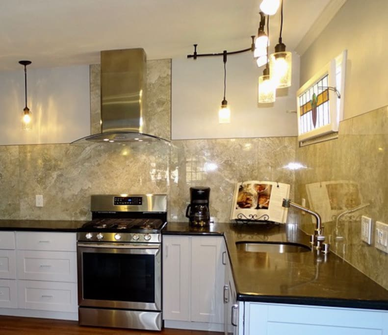 Newly remodeled kitchen includes gas range, french door refrigerator, and dishwasher