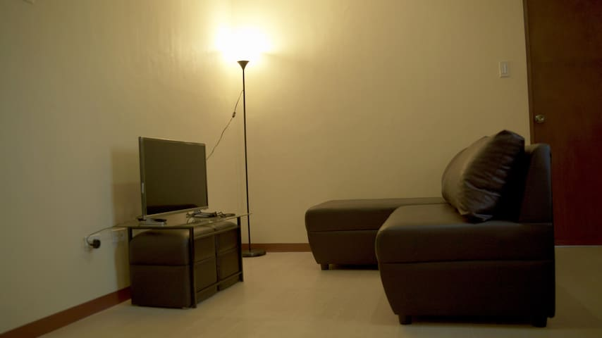 """32""""-inch LED TV with cable channels, 3-seater sofa/lounge"""