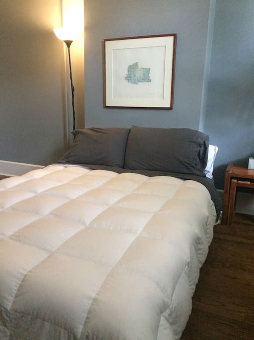 Memory foam bed with down comforter.