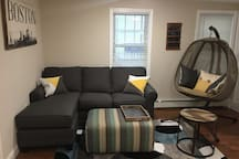 Living room area with a comfortable couch and swing chair