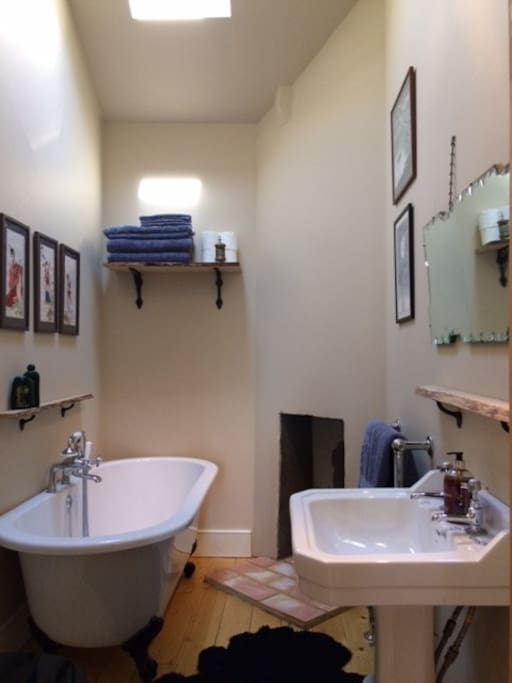 Newly fitted spacious bathroom and toilet with deep bath and sit in shower.
