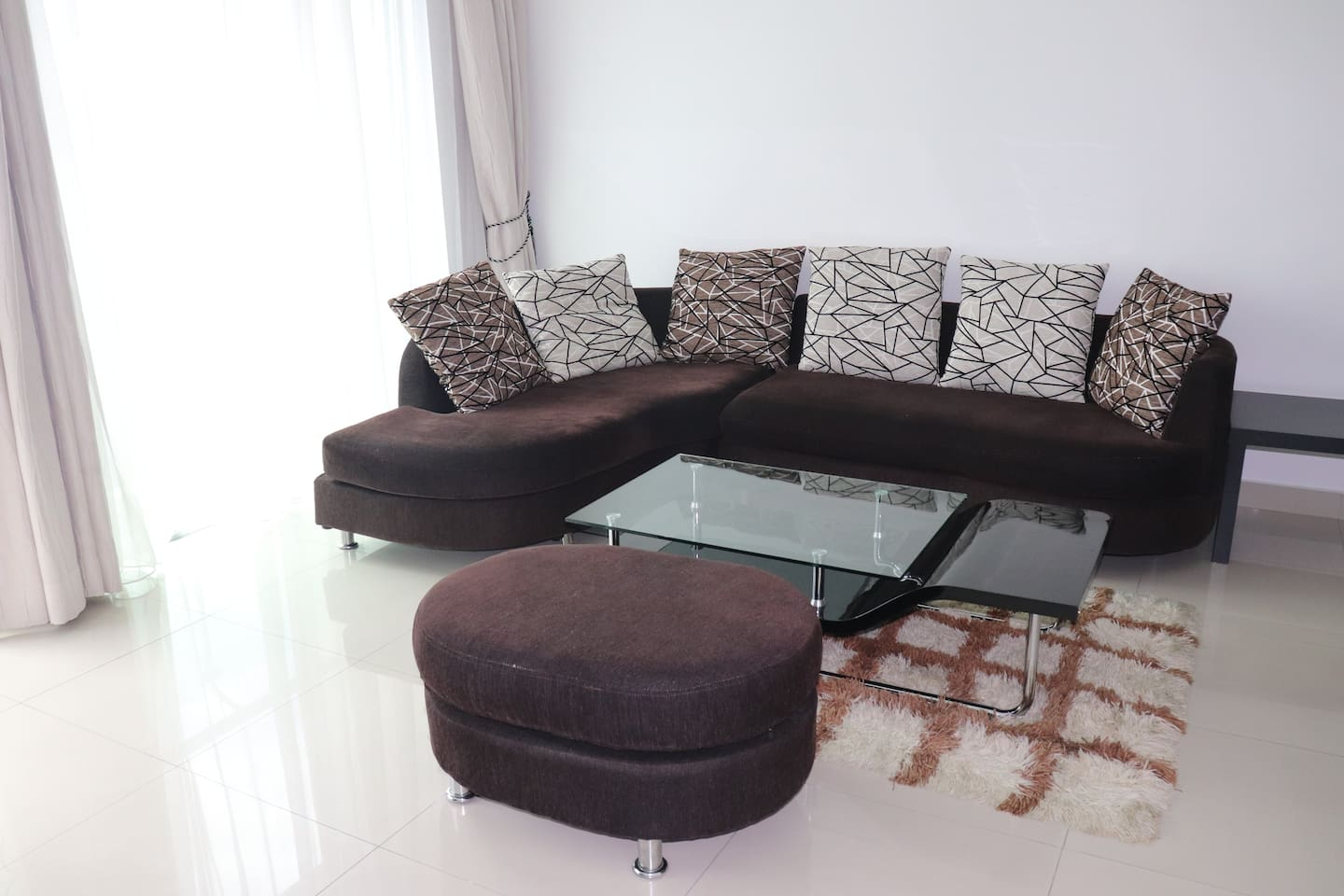 Living Room with big sofa which can accommodate 1 adult.