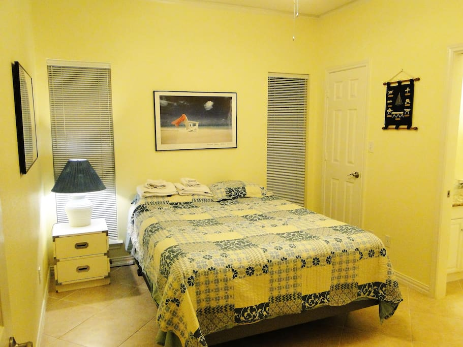 Queen bed room, bright and cheery, ample room to relax.