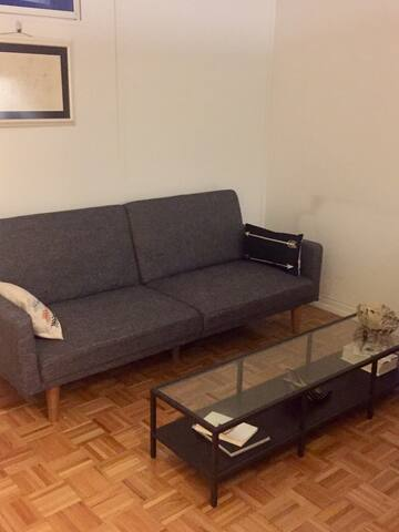 Futon bed in Chelsea with kitchen and bathroom.