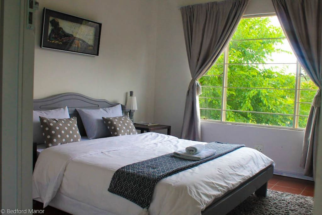 Master bedroom with a view of Rietspruit River and wetland reserve