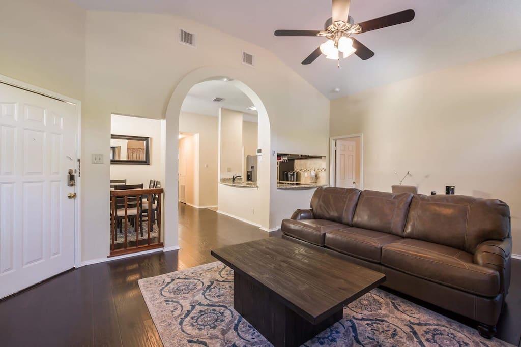 Living Room Open Floor Plan. Desk Behind Couch