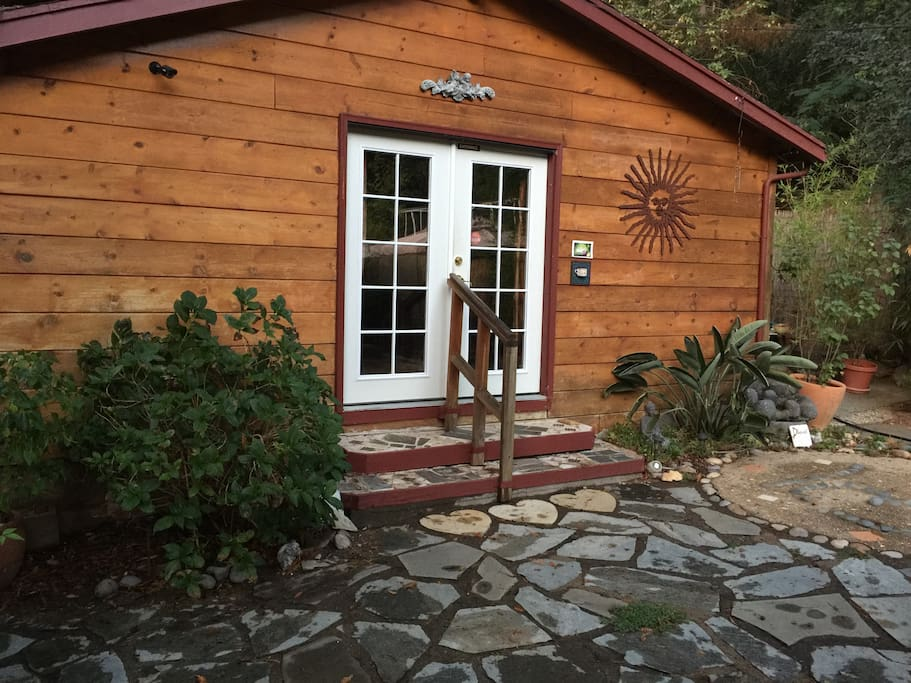 Our rustic, cabin. A 400 square foot, one wall style old school cabin. Lots of charm and magic.