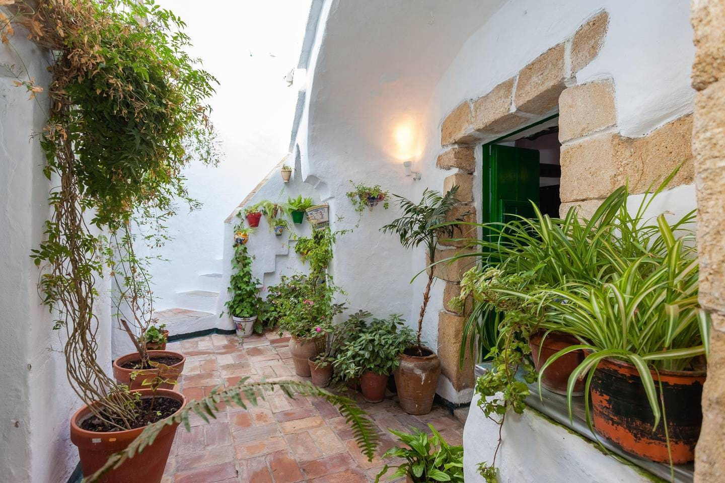 Part of your private space in a centuries-old home. Most homes in the Old Town have shared courtyards or no outdoor space.