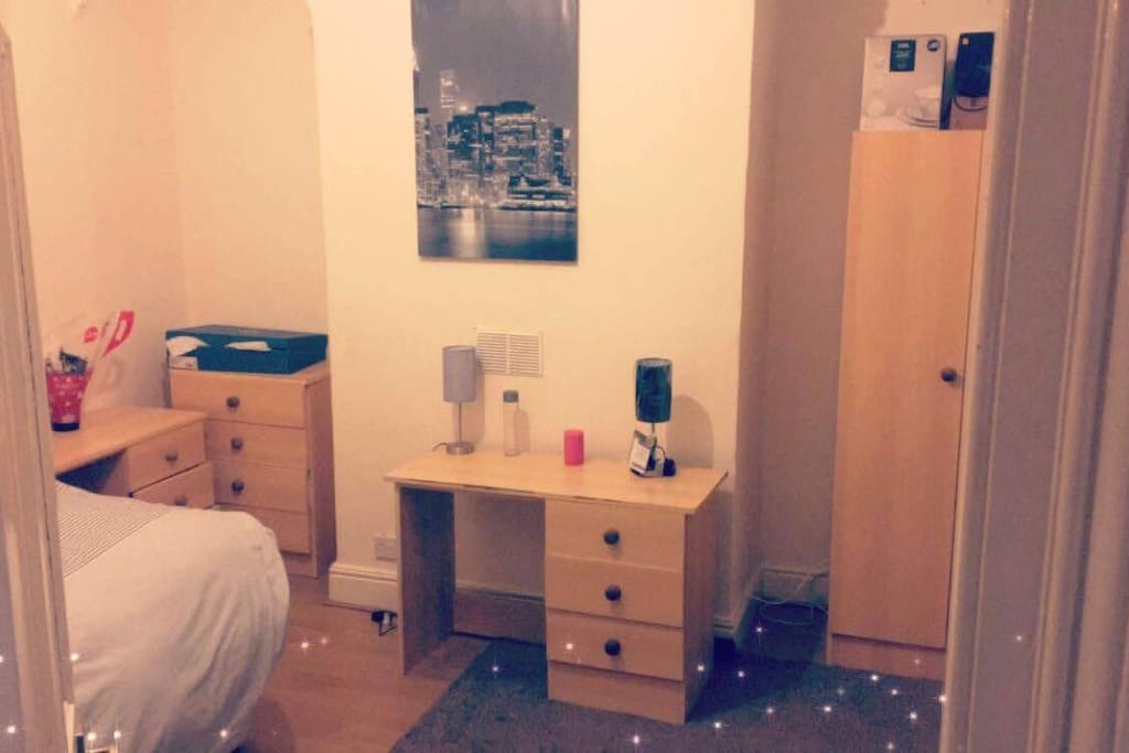 An amazing room with a lot of space and a comfortable double bed
