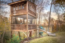 This is an amazing fall shot of the treehouse. Off in the distance is the river and Boulevard Bridge (Nickel Bridge). The treehouse is situated on 5 acres of woodland, some of which also has the James River Park System trail running through it. It's very private--in the center of Richmond, VA, right on the center of the East Coast!