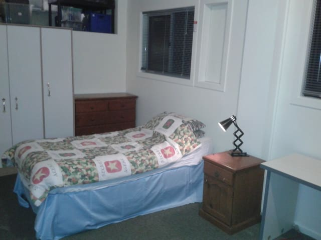 Large bedroom with a single bed. Light and airy.