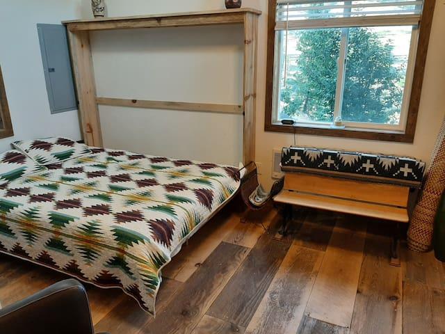 Queen murphy bed in TV room