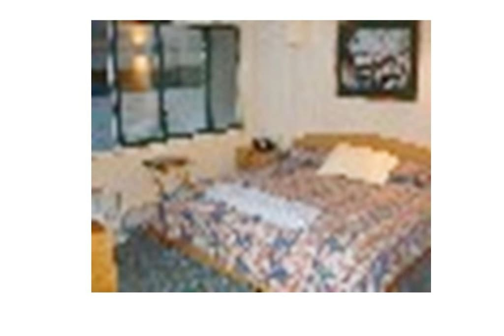 Master BR King size (not Queen) bed with private bathroom en suite and TV. All linens included.