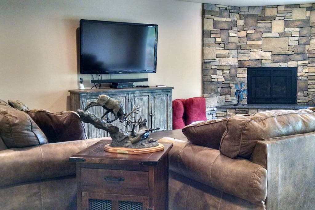 Sit by the fire and relax in your super comfortable living area.