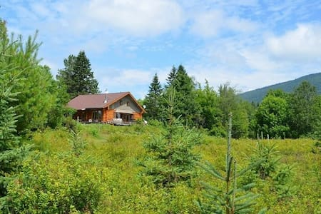 Quebec City log home w/ river frontage & mountains
