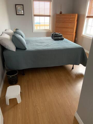 Bedroom #3 with queen bed, dresser and closet.
