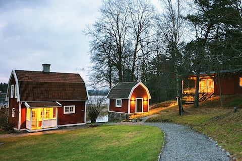 To the left is the romantic traditional Swedish house and to the right is the Studio. Everything located just by the lake in a very quiet and calm surrounding.