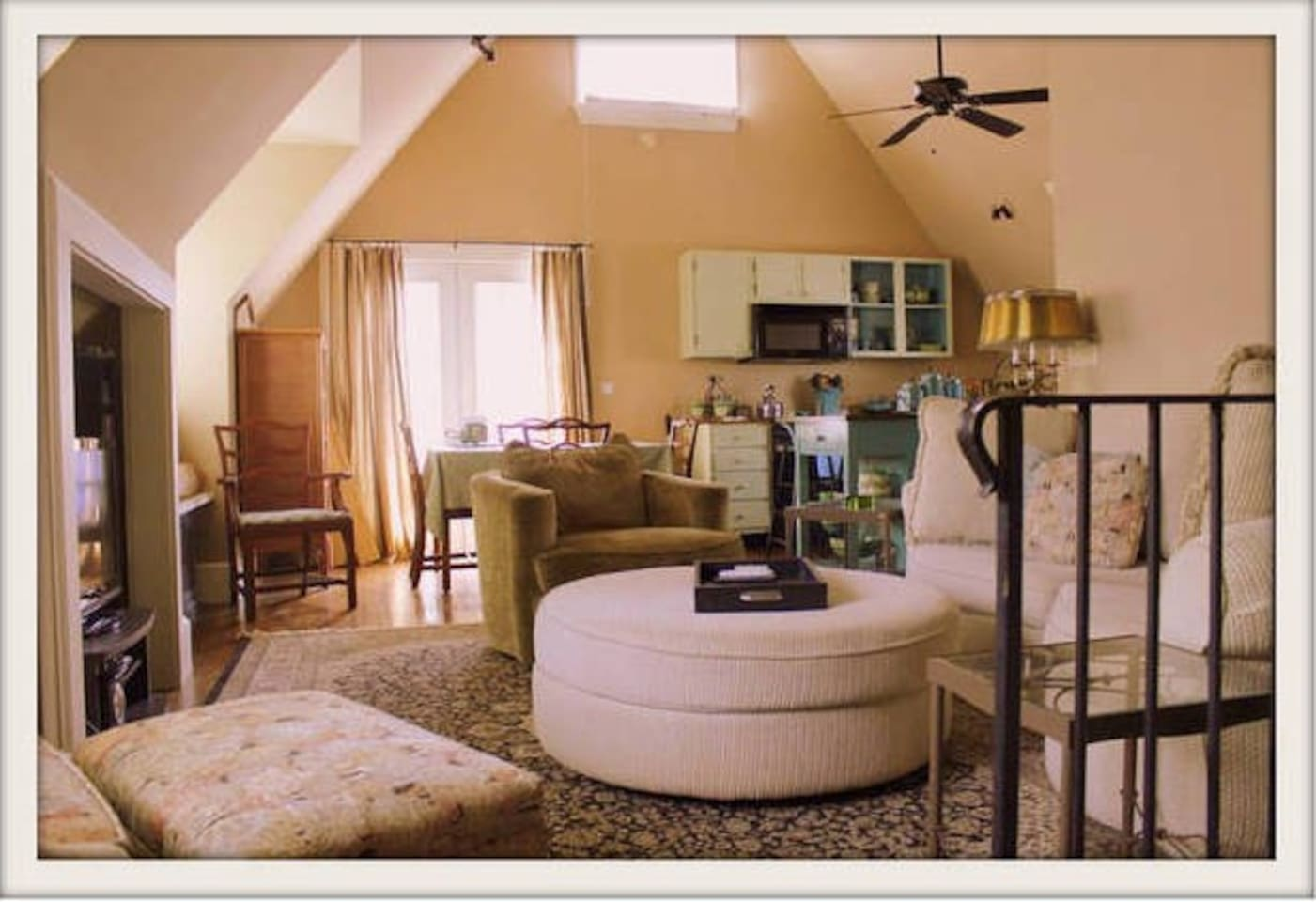 Vaulted ceilings and hardwood flooring throughout carriage house.