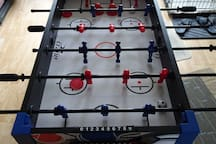 combination foosball-air hockey game (not full-sized) on sunporch