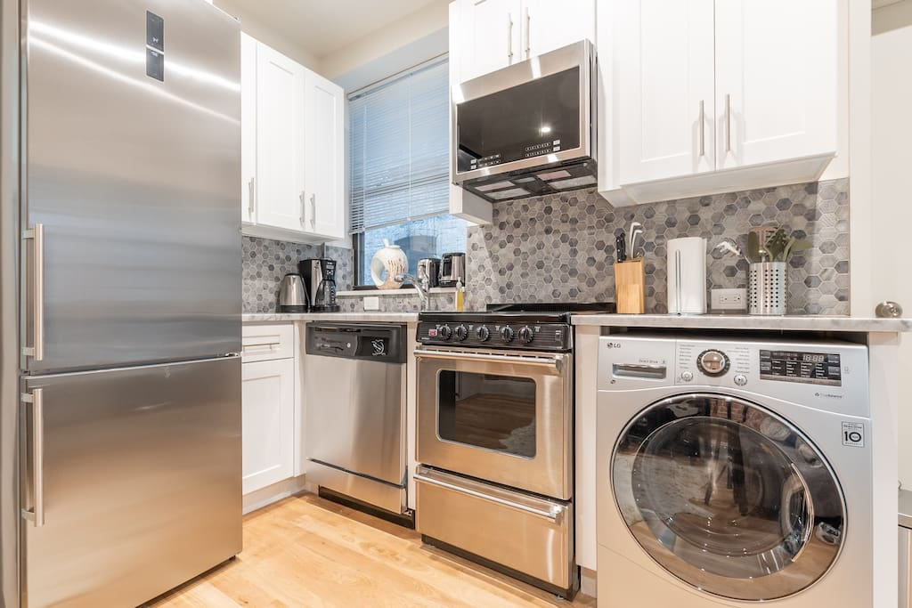 Recently renovated kitchen with brand new High-End Stainless Steel Appliances, Washing Machine, Stunning Mosaic backsplash. All amenities provided for cooking purposes