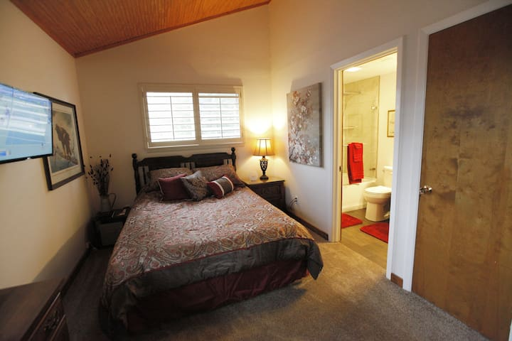 """Master Bedroom with 32"""" Mounted HDTV and Dish Network"""