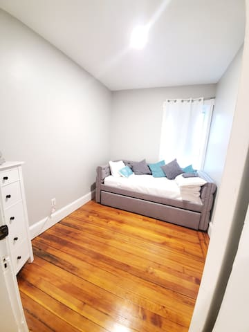 Twin bedroom with pull out under the bed